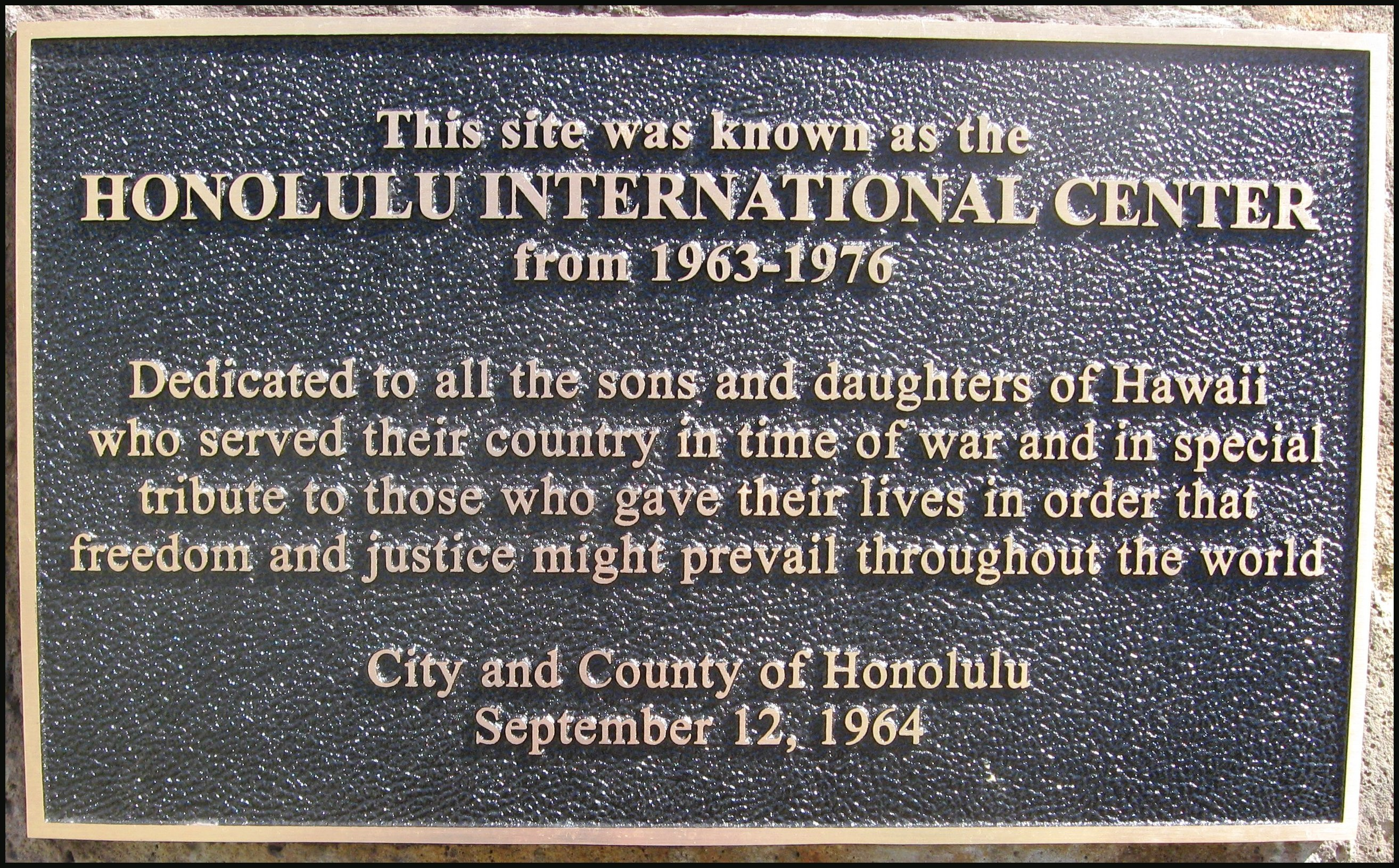 Replacement war memorial plaque at Blaisdell Center. First and second lines were added to original text.